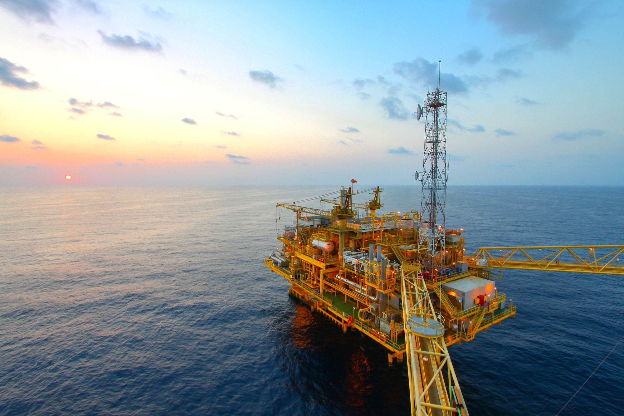 Oil and gas platform in sunset or sunrise time